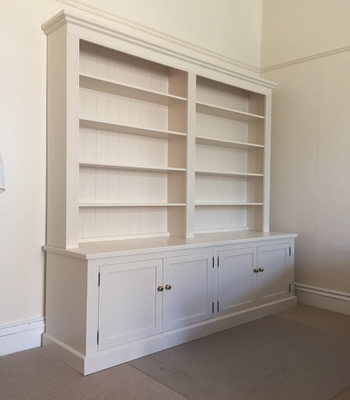 Double Bookcase With Deep Four Door Base